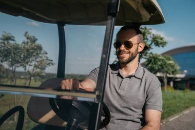 Golf player spending time at golf course