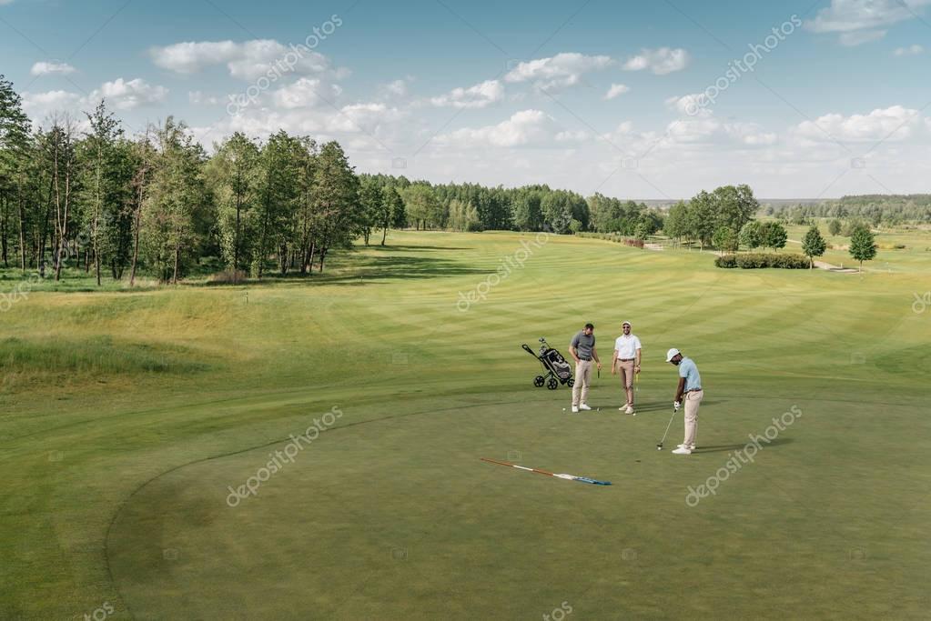 sportsmen playing golf