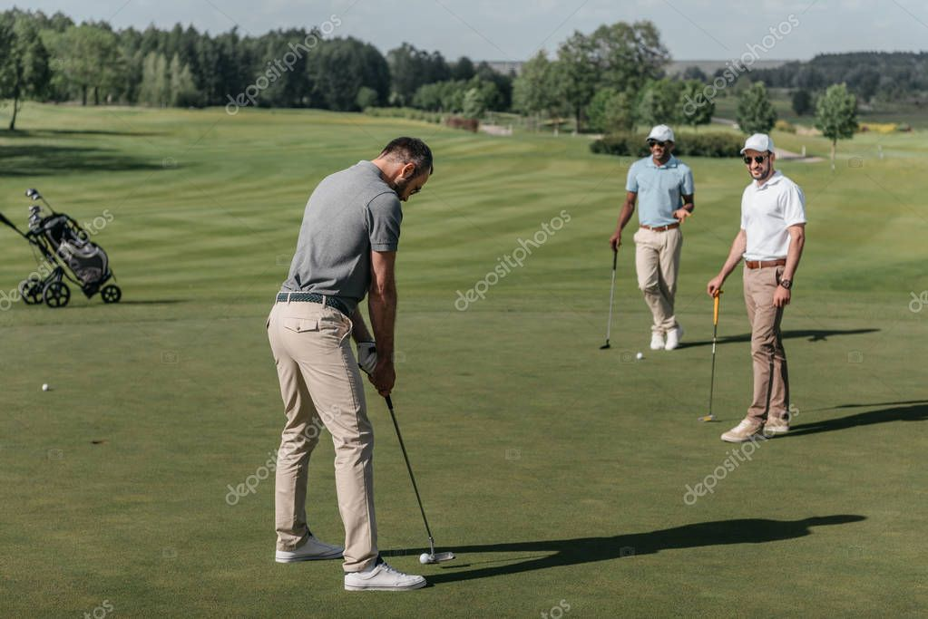 young friends playing golf