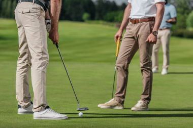 Sportsmen playing golf