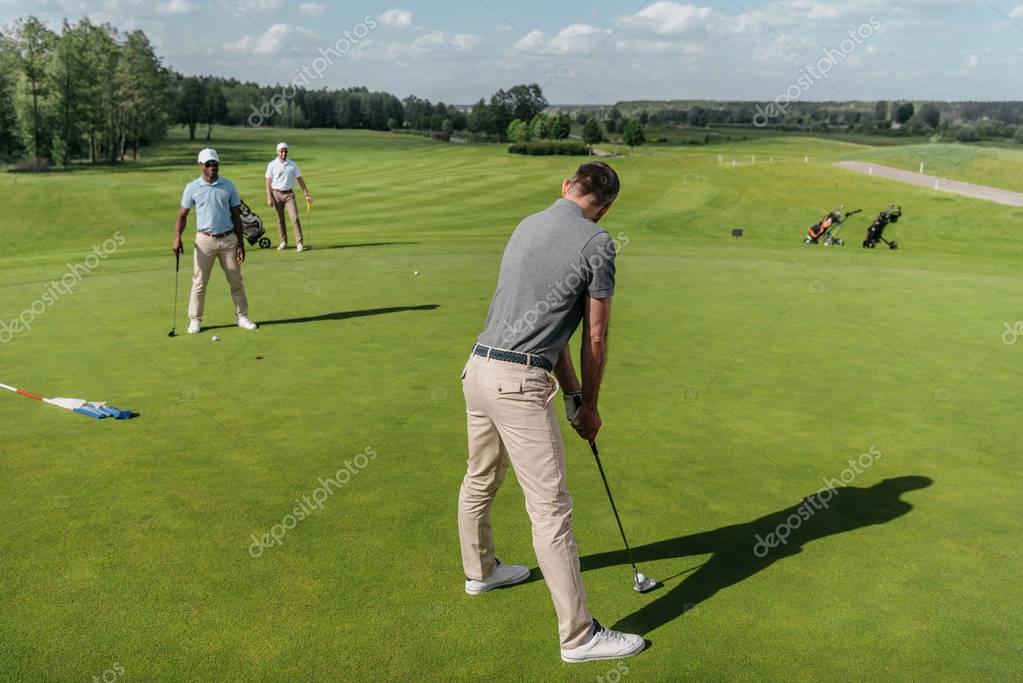 casual men playing golf