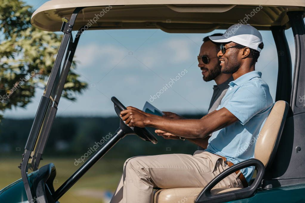 friends talking while riding golf cart