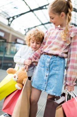 Children holding shopping bags