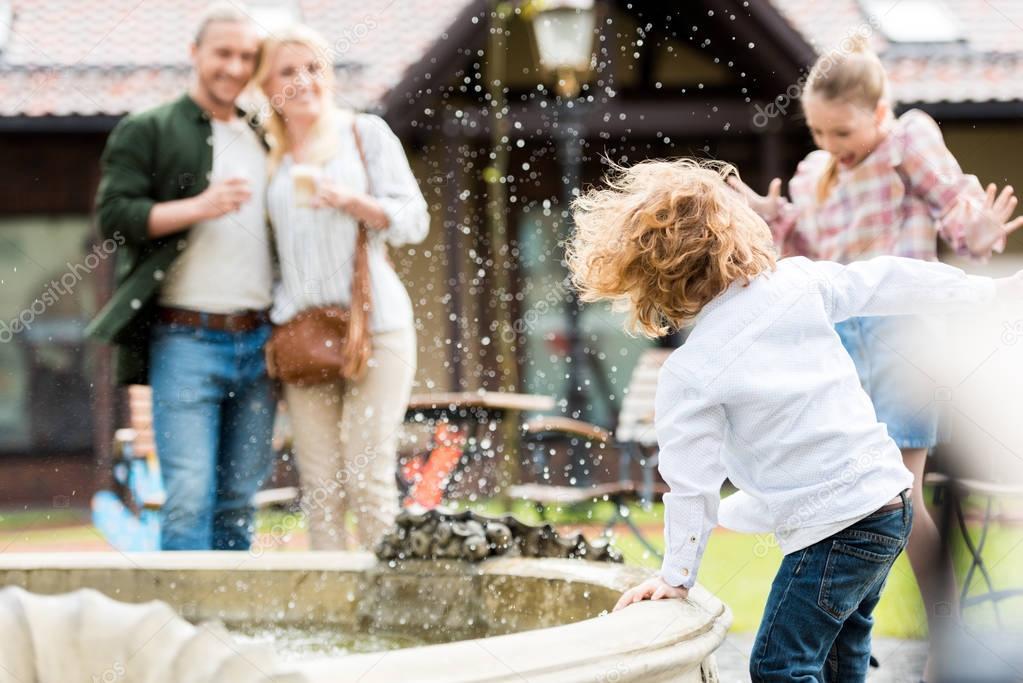 Kids playing near fountain