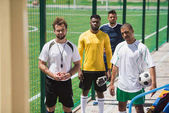 Fotografie Multikulti-Fußballspieler