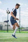 Fotografie soccer player with ball