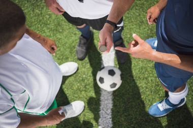 referee and soccer players