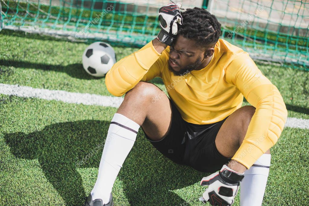 african american goalkeeper at pitch