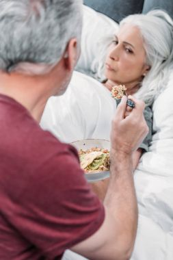 Man taking care of wife