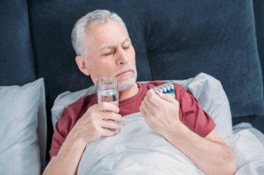 sick man with medicines