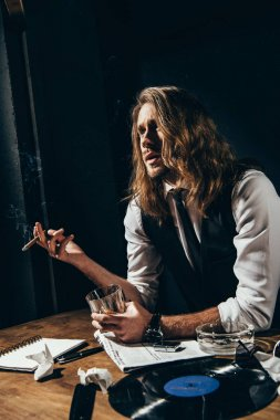 Man drinking alcohol and smoking