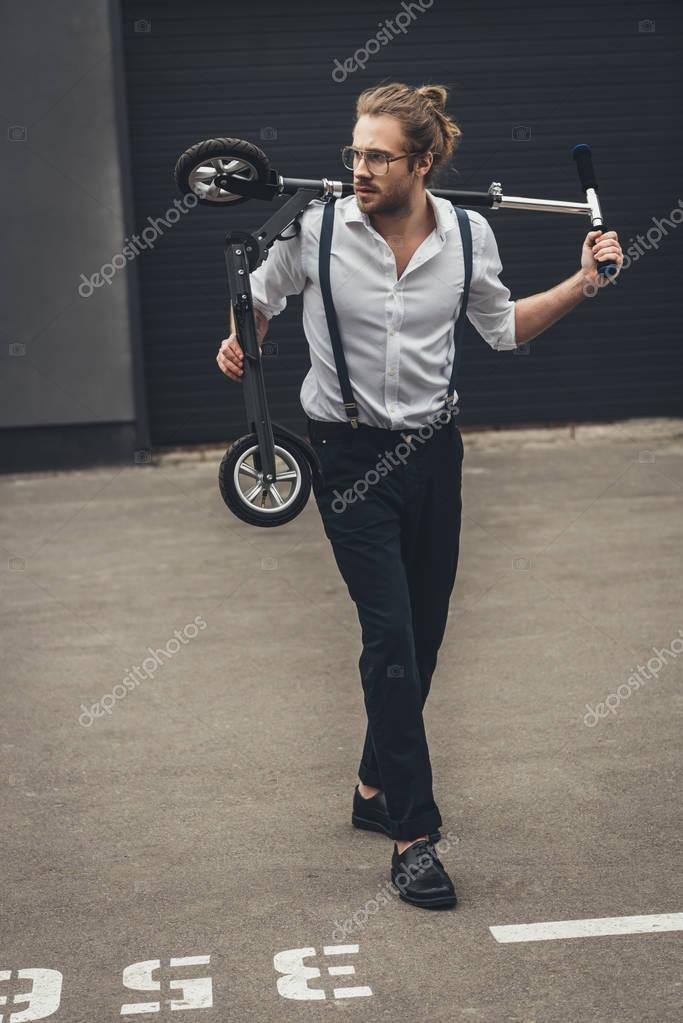 Stylish man with scooter