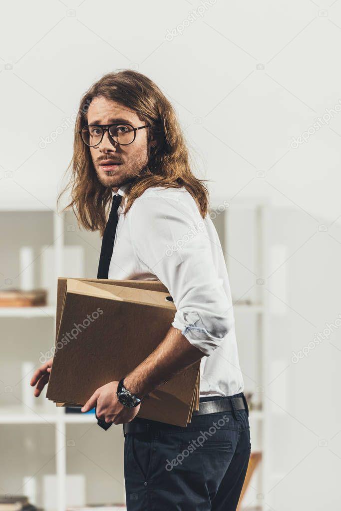 Businessman holding folders