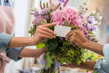 florists holding blank card