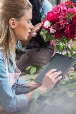 Florist using digital tablet