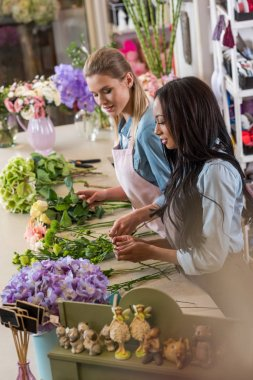 multiethnic florists in flower shop