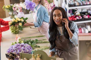 Florist talking on smartphone