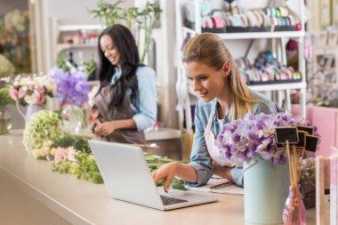 florist using laptop
