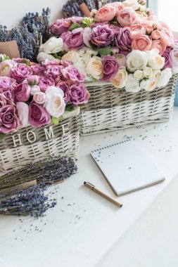 flowers in wicker baskets and notebook