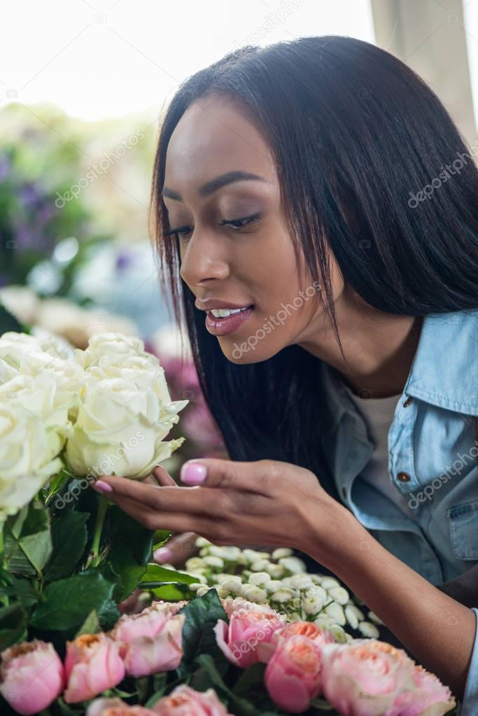 african american florist with flowers