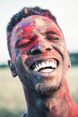african american man at holi festival
