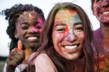 multiethnic friends at holi festival