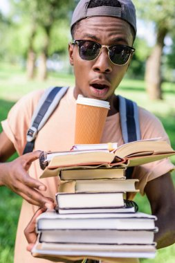 young man with pile of books