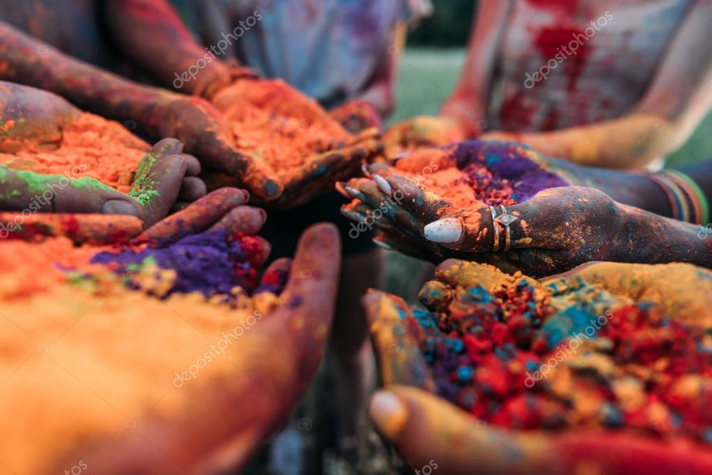 colorful holi powder in hands