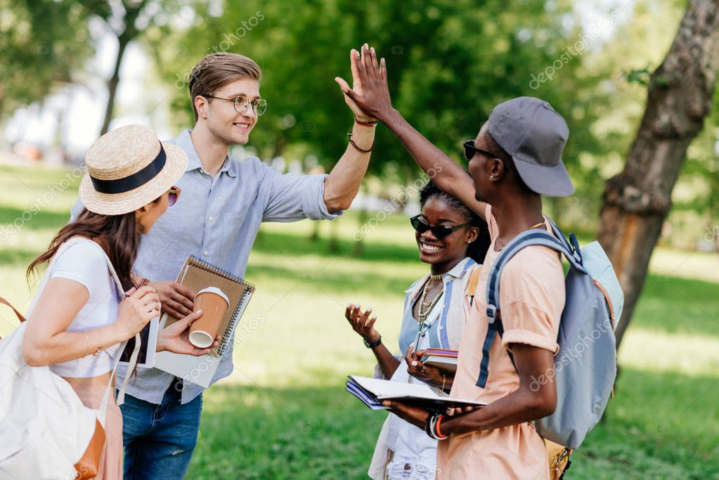 multiethnic students giving high five