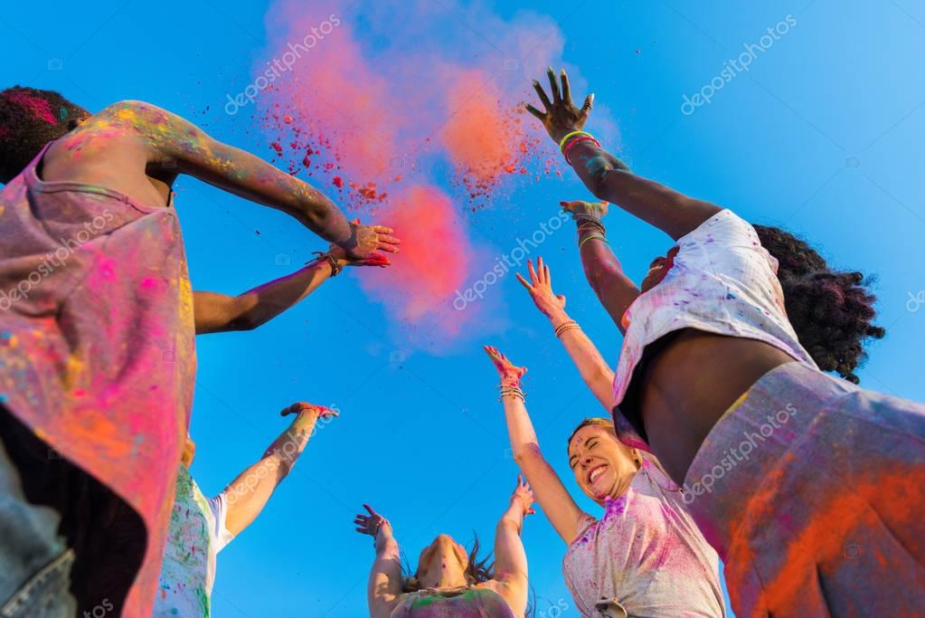happy friends at holi festival