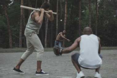 multiethnic men playing baseball