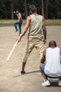 Men playing baseball