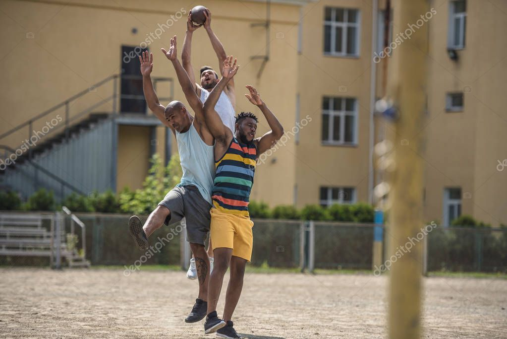 multicultural men playing football