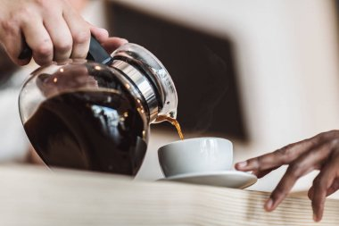 waiter pouring coffee
