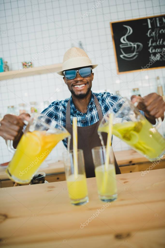 bartender pouring lemonades