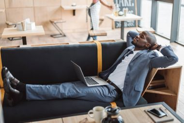 businessman relaxing with laptop