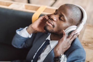 african american businessman listening music