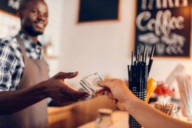 barista taking cash payment