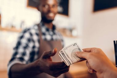 barista taking cash payment