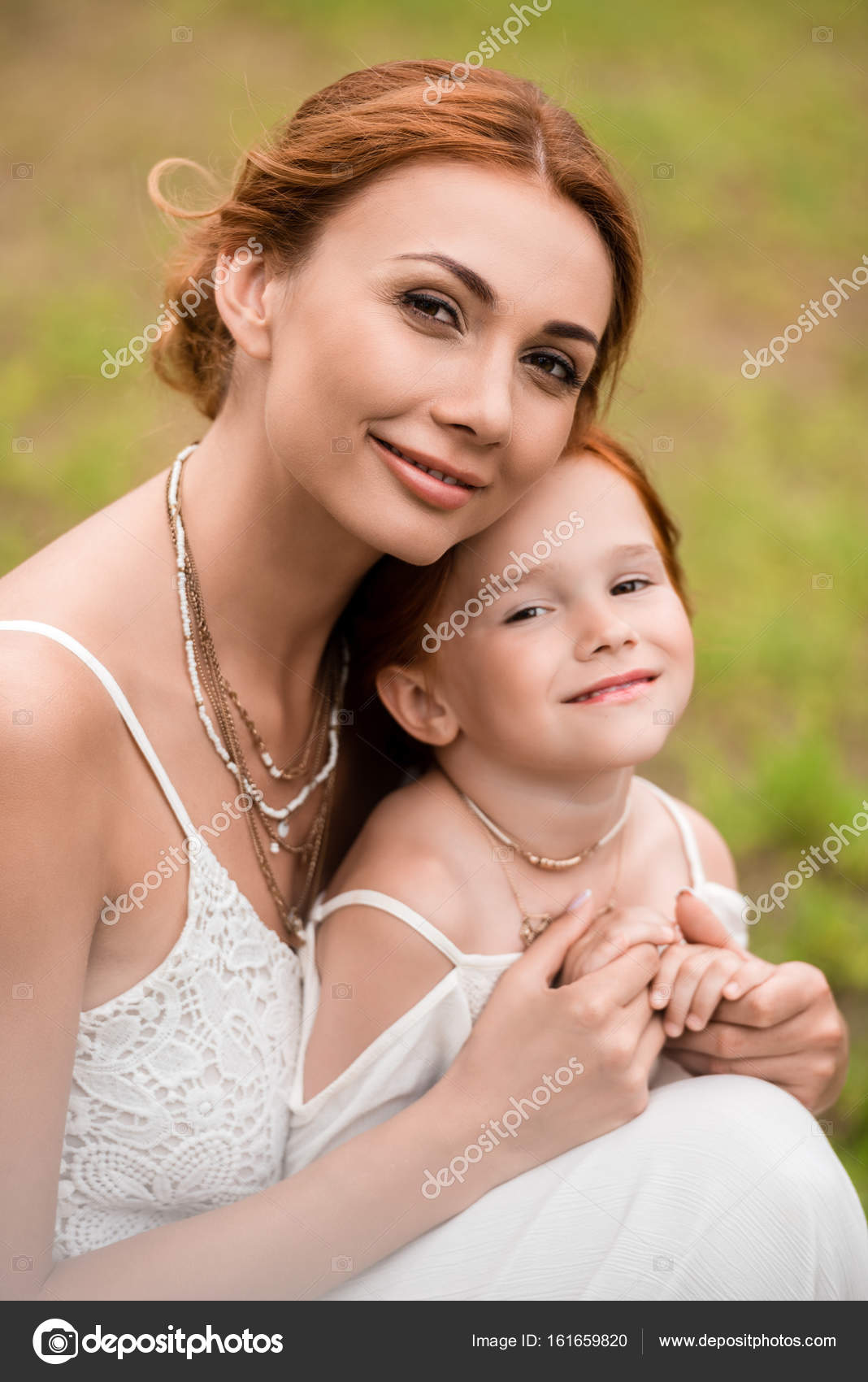 Mother And Daughter Hugging Stock Photo - Download Image
