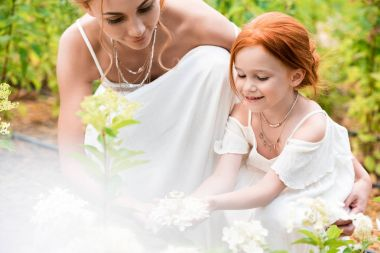 Mother and daughter with flowers