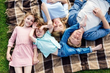 happy family lying on plaid