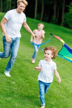 happy family playing with kite
