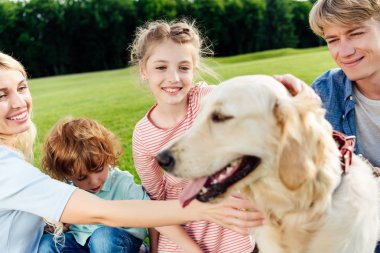 Family with dog at picnic