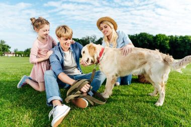 happy family with dog at park