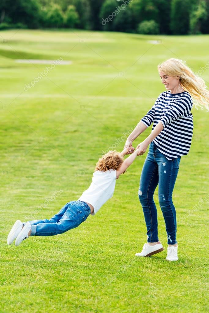 Happy mother with son at park