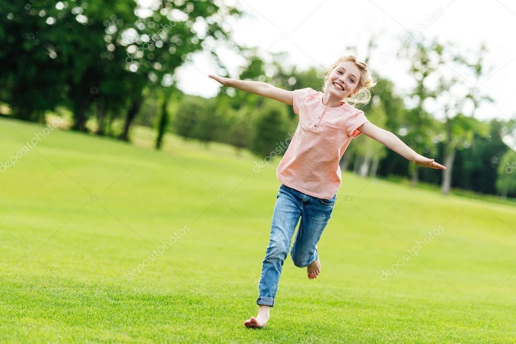 Happy girl running at park