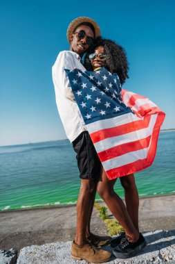 African american couple hugging each other