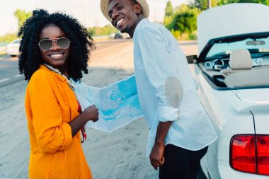 african american couple with map