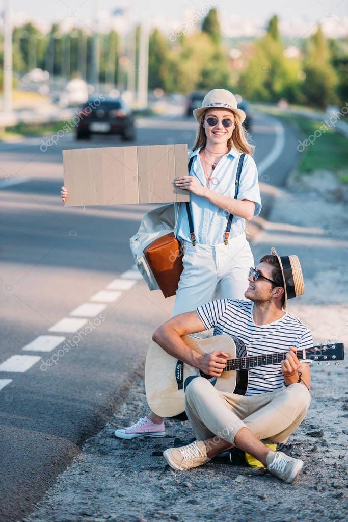 couple hitchhiking together